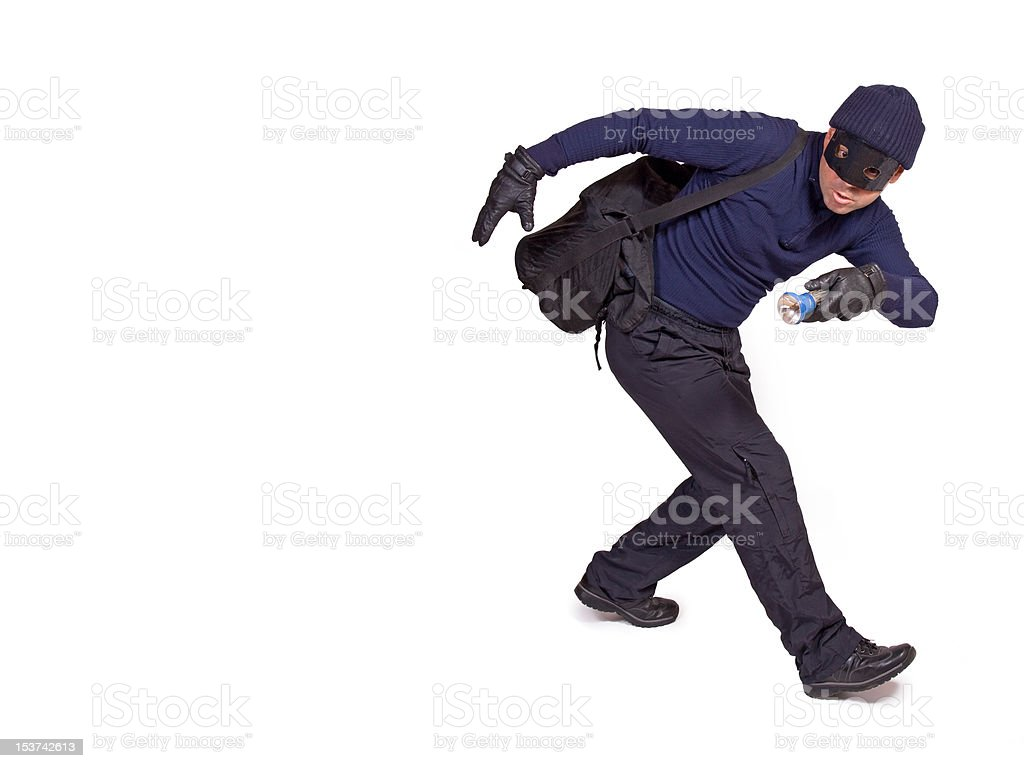 thief with hand torch stock photo