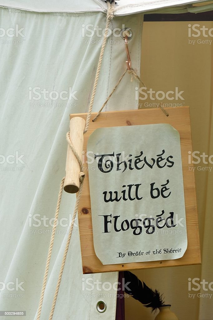 Thieves flogging sign stock photo