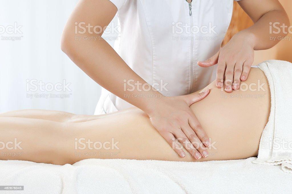 Thighs massage stock photo