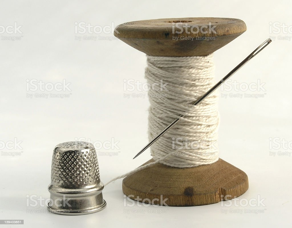 thimble, needle and thread royalty-free stock photo