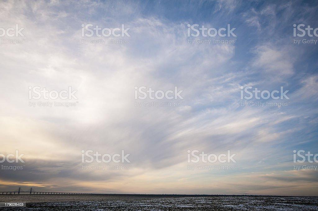 thin clouds over öresundsbron royalty-free stock photo