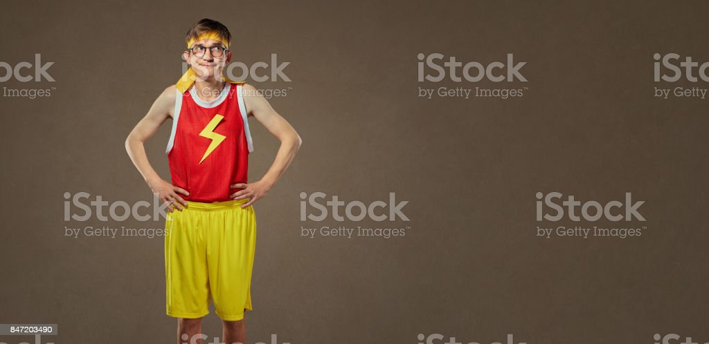 A thin, funny guy in sports clothes and glasses. stock photo
