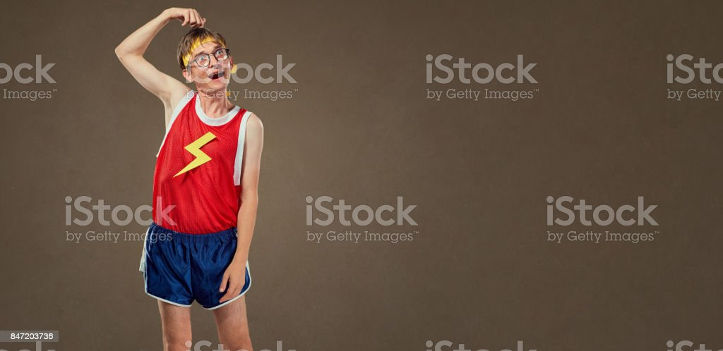 A thin funny guy in sports clothes is a fool stock photo