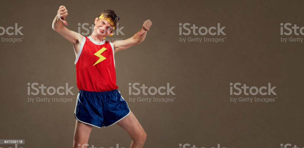 A thin funny guy in sports clothes shows his finger down stock photo