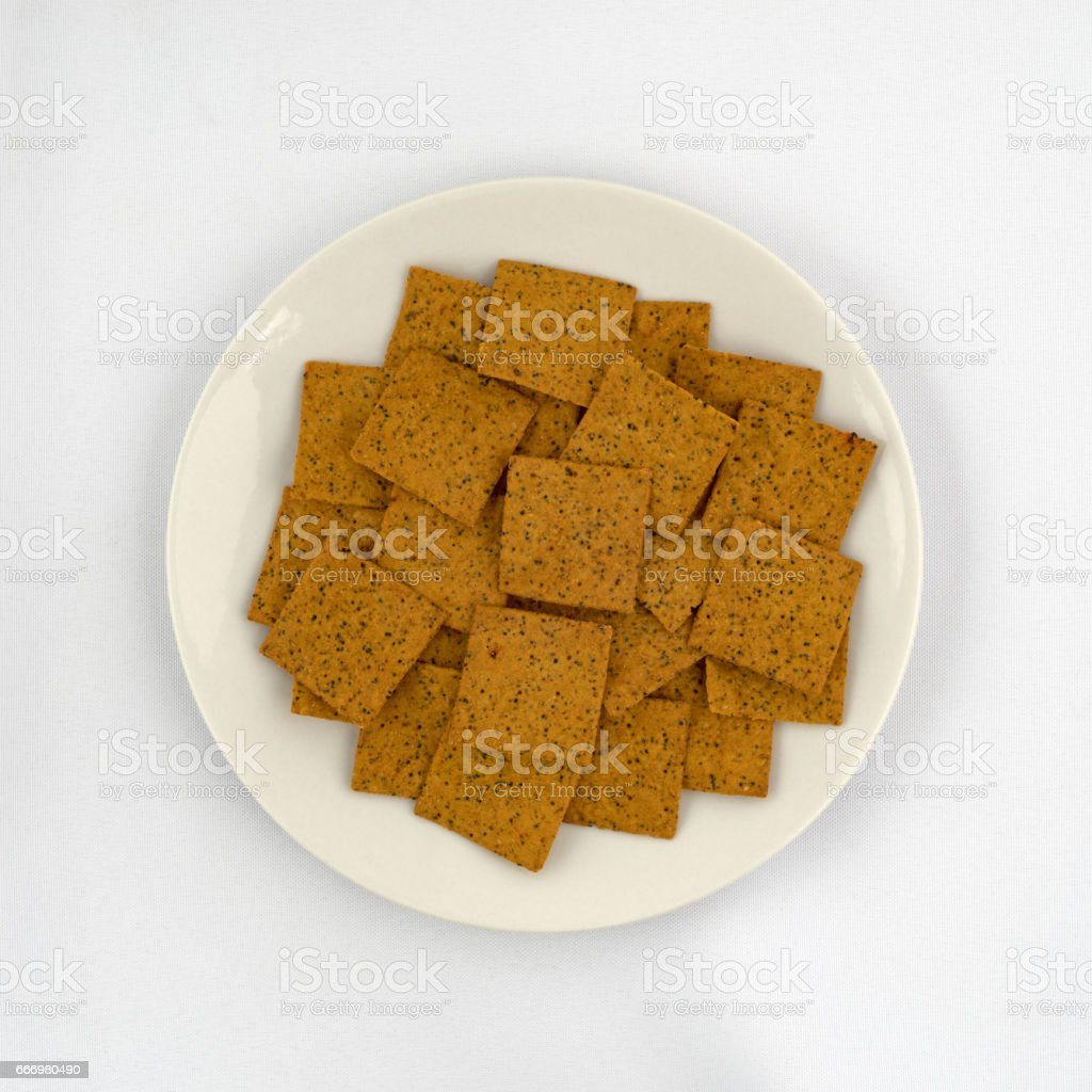 Thin gourmet snack crackers on a plate stock photo