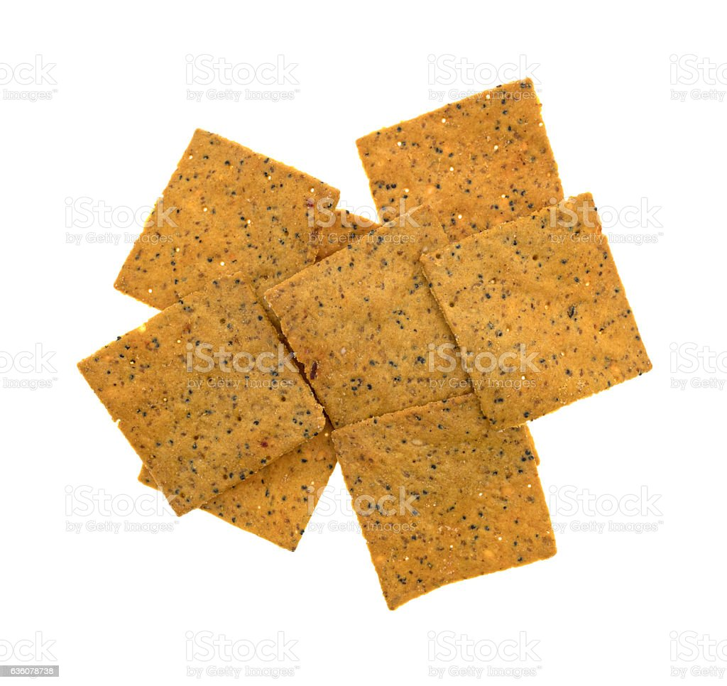 Thin gourmet snack crackers on a white background stock photo