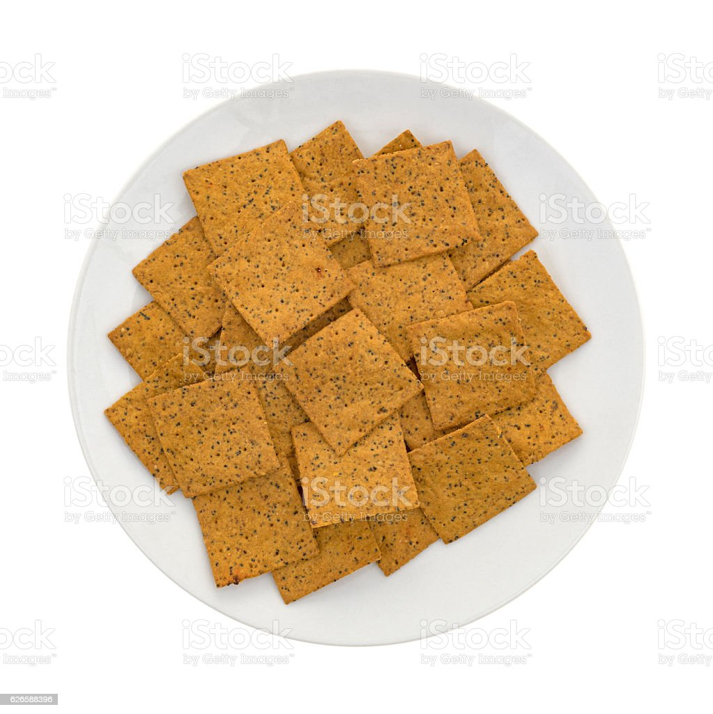 Thin gourmet snack crackers on a white plate stock photo