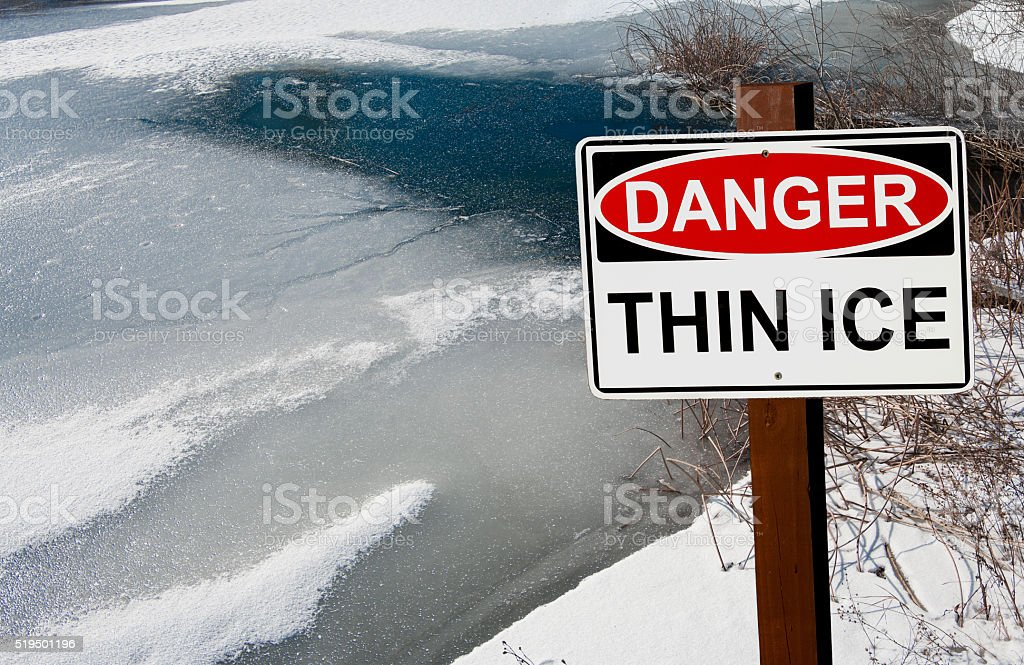 Thin Ice Warning Sign stock photo