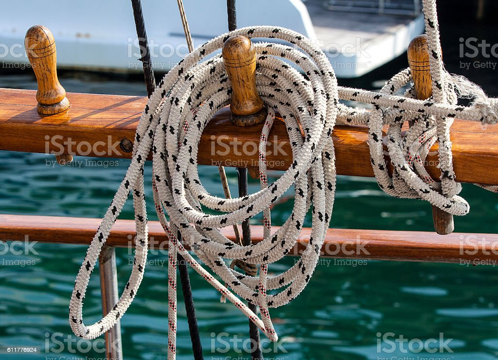 thin long sturdy rope on a sailing boat stock photo