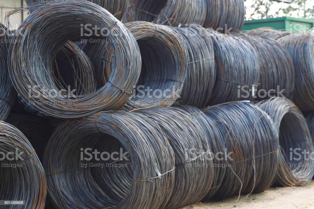 Thin metal reinforcement with corrugation wound into bays at the metal products warehouse stock photo