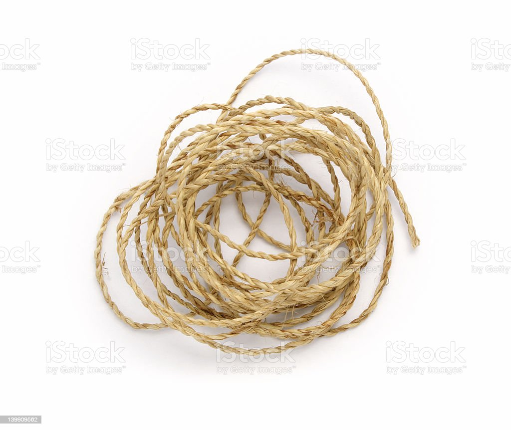 A thin rope rolled with a white background stock photo