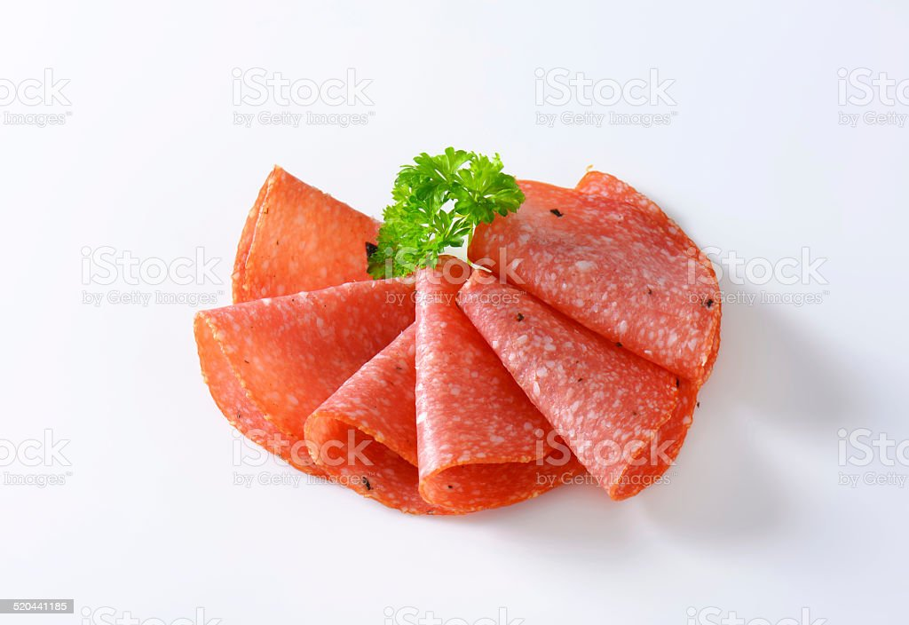 Thin salami slices stock photo