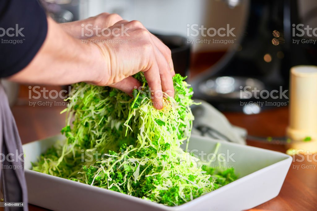 Thin sliced cabbage in a salad on kitchen table stock photo