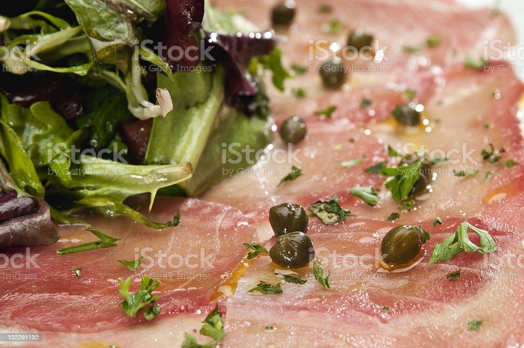 Thin sliced Tuna carpaccio close up royalty-free stock photo