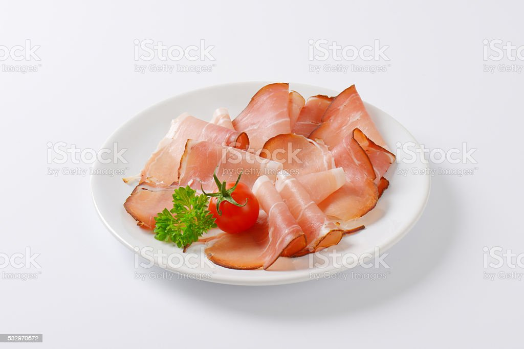 Thin slices of Black Forest ham stock photo