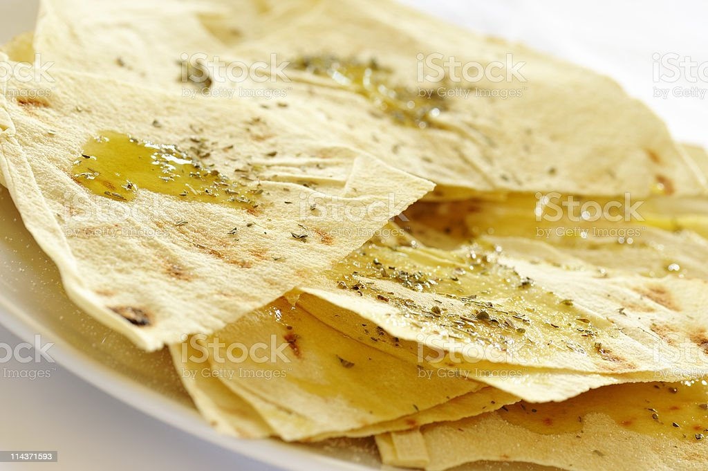 Thin tortilla chips with sauce on top stock photo