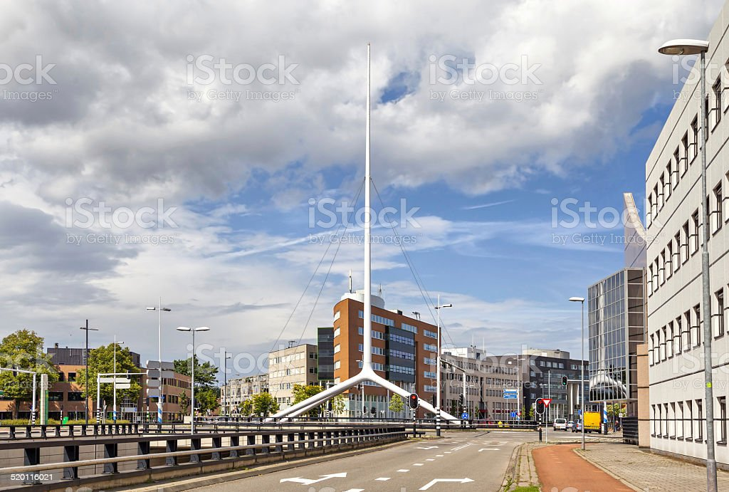 Thin white steeple on one of the crossroads of Eindhoven stock photo