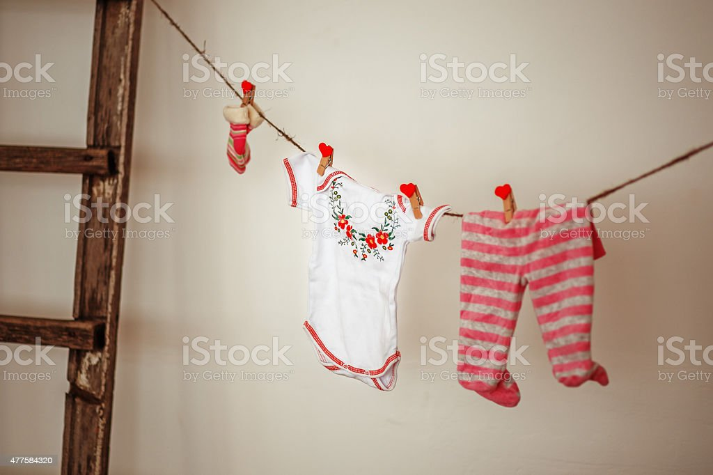 Things for the newborn hanging on rope stock photo