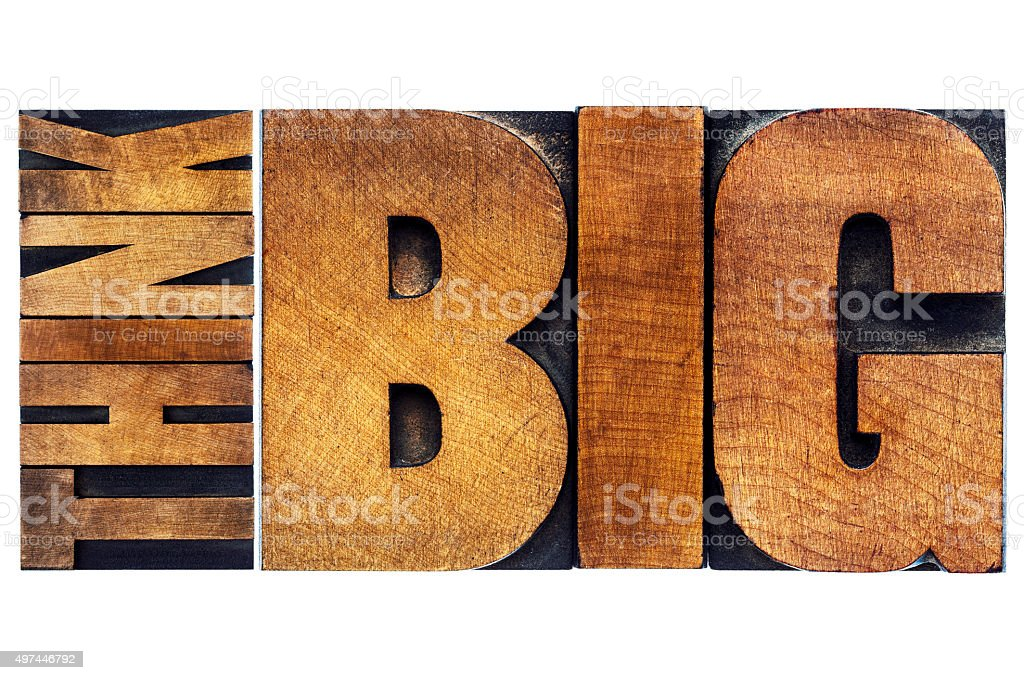 think big in old grunge wood type stock photo