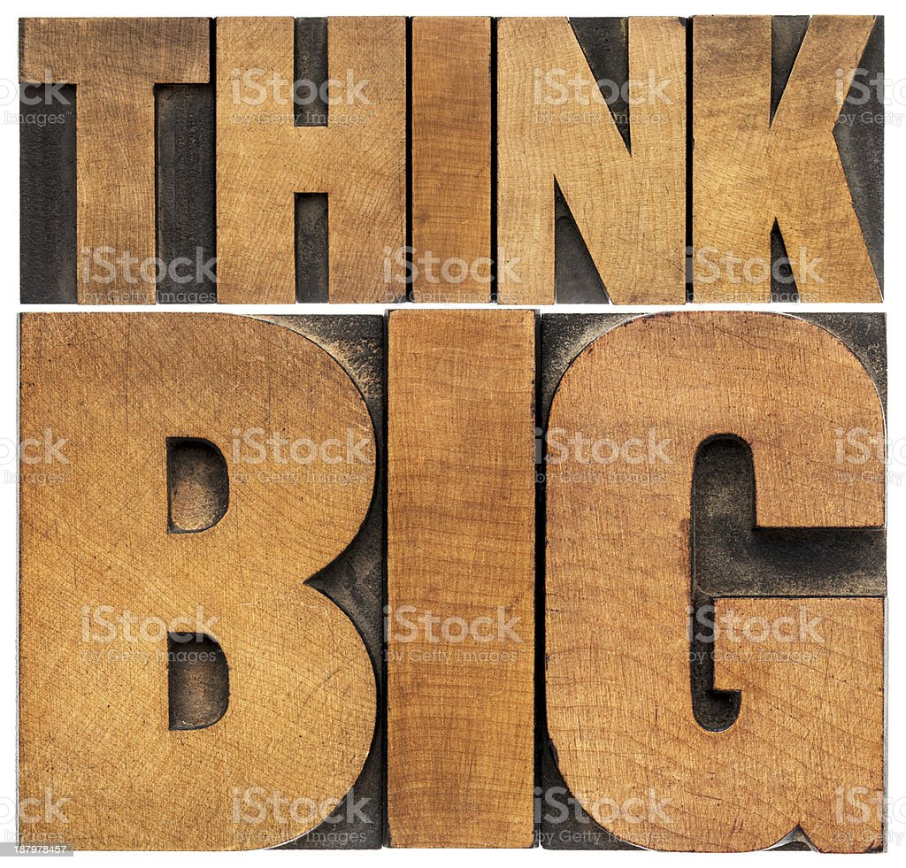 think big in wood type stock photo