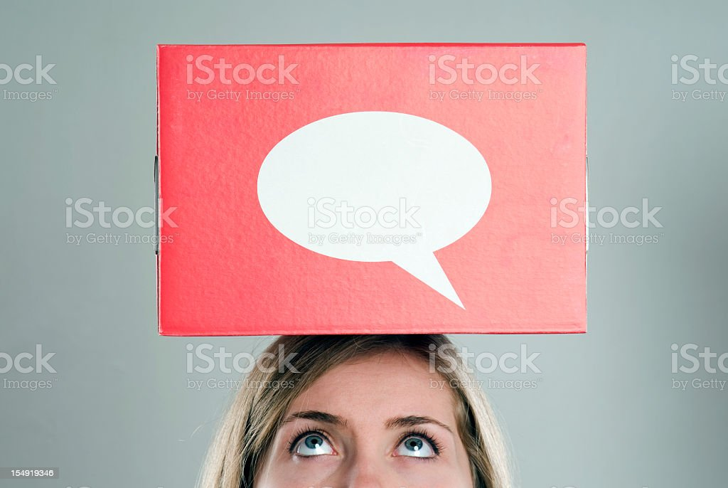 A think box placed on top of a woman's head royalty-free stock photo