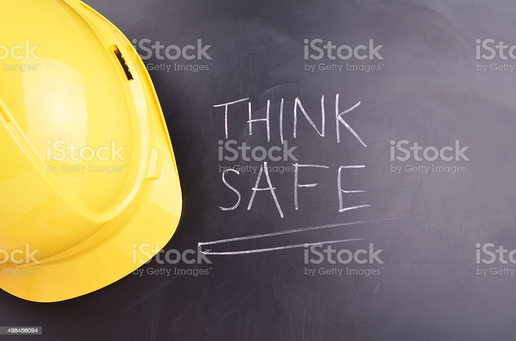 Think safe handwritten in white chalk on a blackboard with a yellow...
