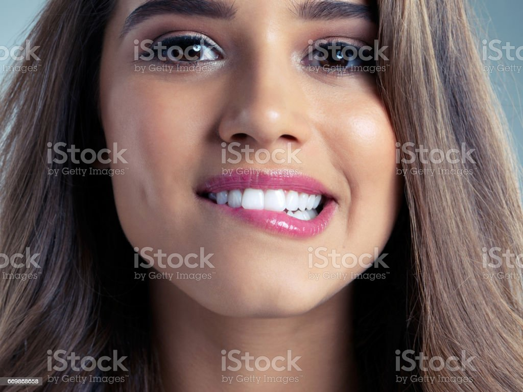 I think she has lipgloss-appeal stock photo