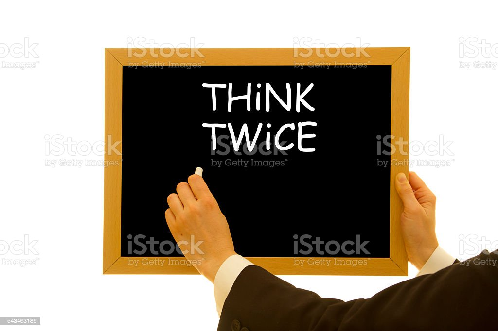 Think twice written on a small blackboard stock photo
