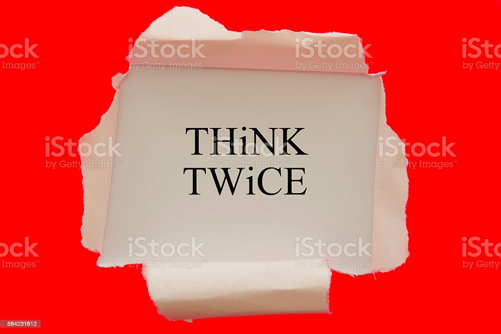 Think twice written under torn paper stock photo