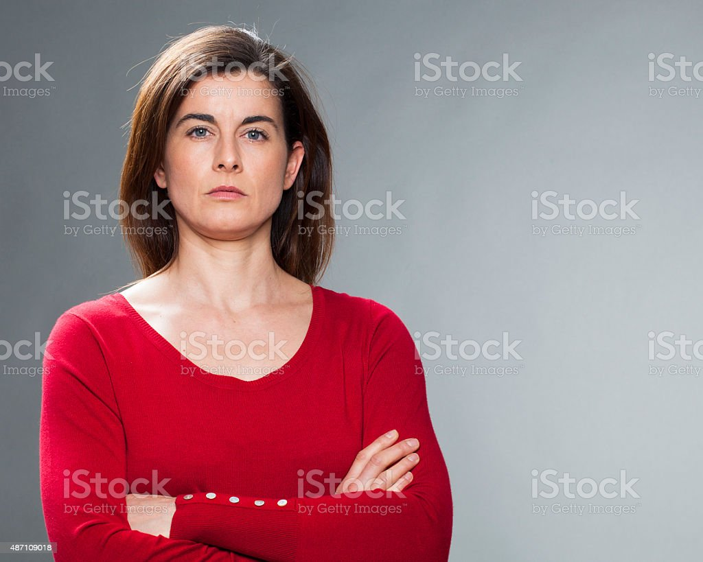 thinking 30s brunette businesswoman looking severe stock photo