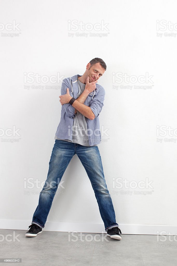 thinking 40s man standing with arms folded for reflection stock photo