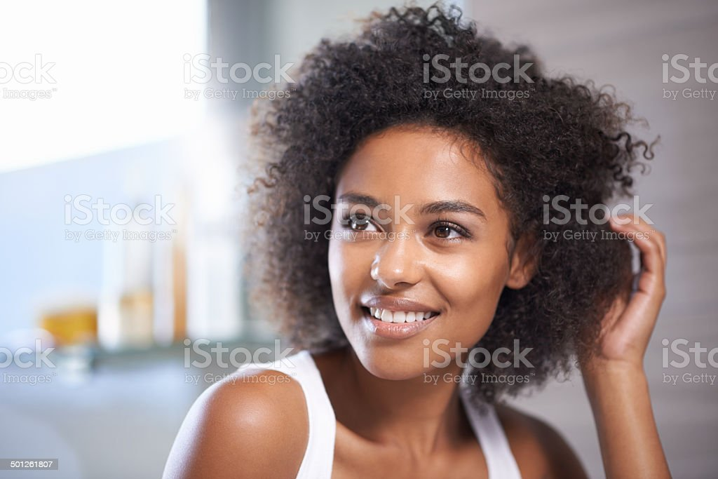Thinking about a new hairstyle stock photo