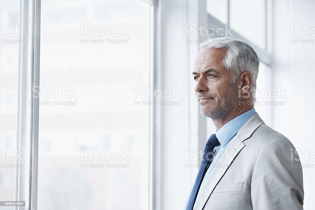 Thinking about his business future stock photo