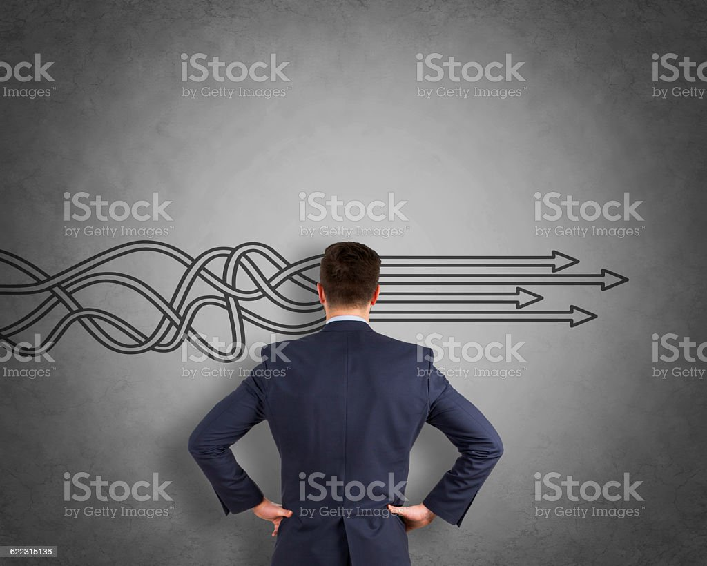 Thinking about structuring business process and solutions on wall stock photo
