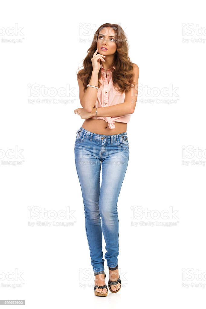Thinking Beautiful Casual Woman Full Length Isolated stock photo