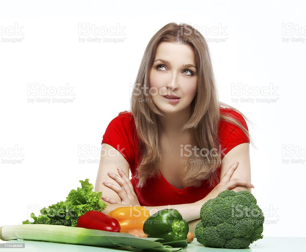 Thinking beautiful young woman with vegetables royalty-free stock photo