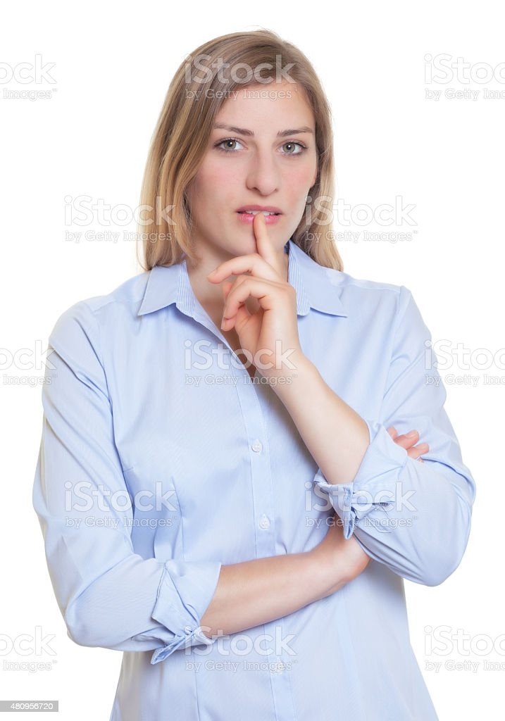 Thinking blonde german woman in blue blouse stock photo