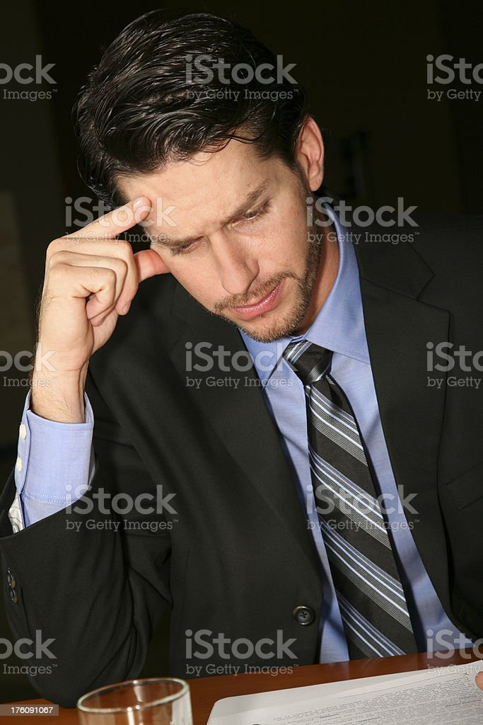 Thinking Business Man With Hand to His Head royalty-free stock photo