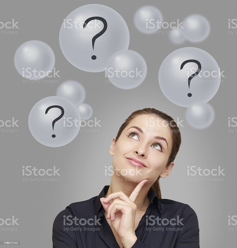 Thinking business woman looking on many bubbles with question royalty-free stock photo