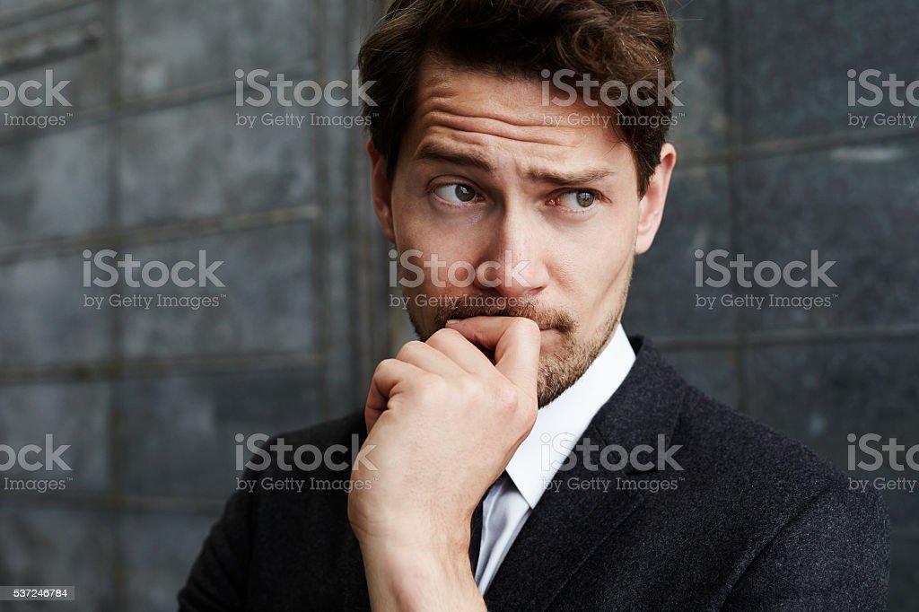 Thinking businessman, looking away stock photo