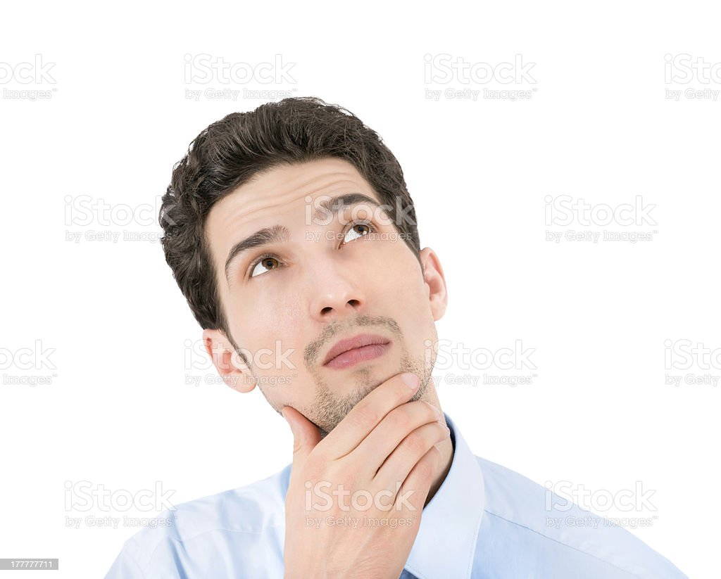Thinking businessman looking up royalty-free stock photo