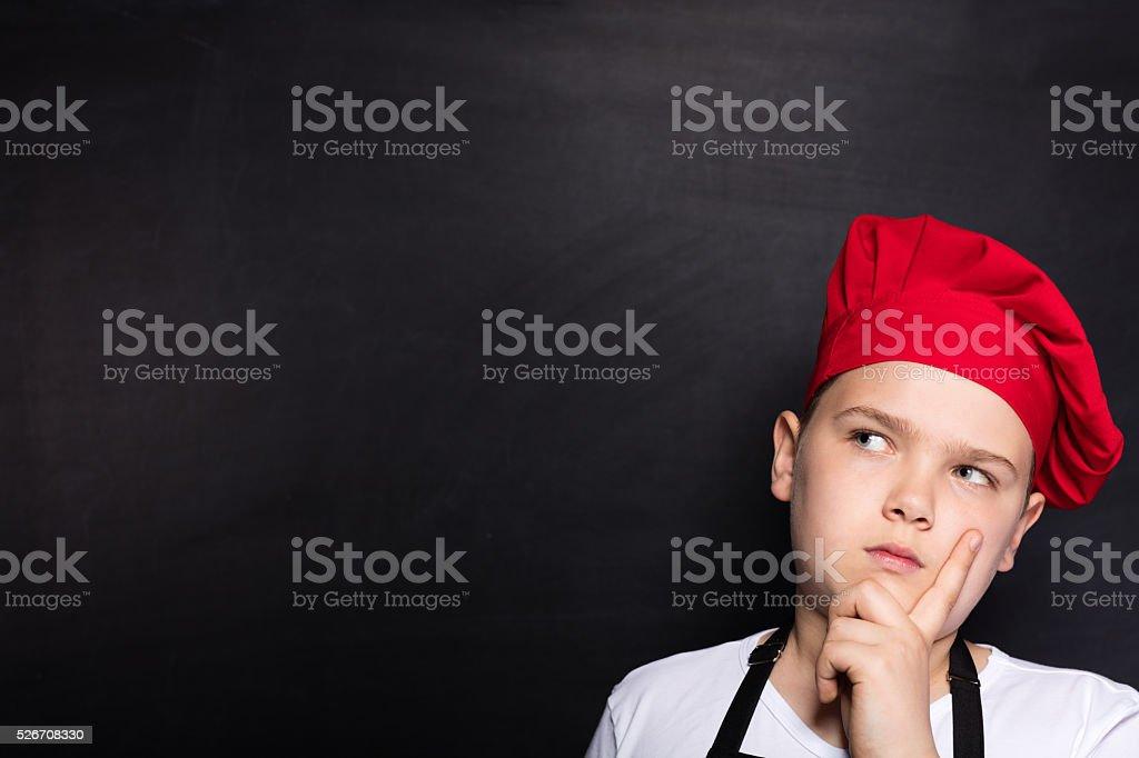 Thinking Child Chef stock photo