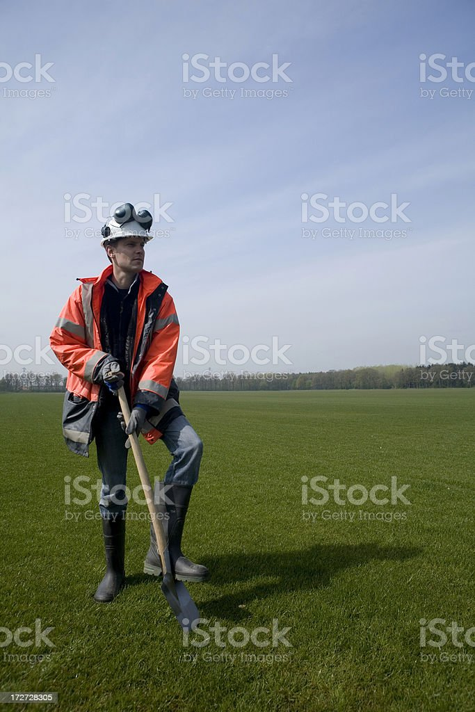 Thinking construction worker royalty-free stock photo