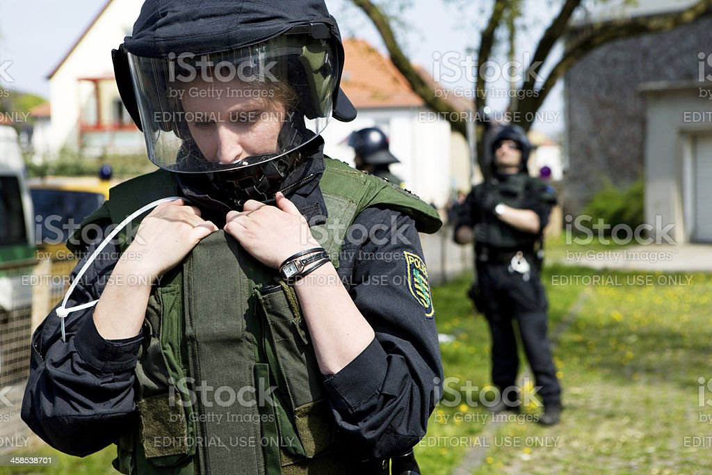 thinking female police officer stock photo