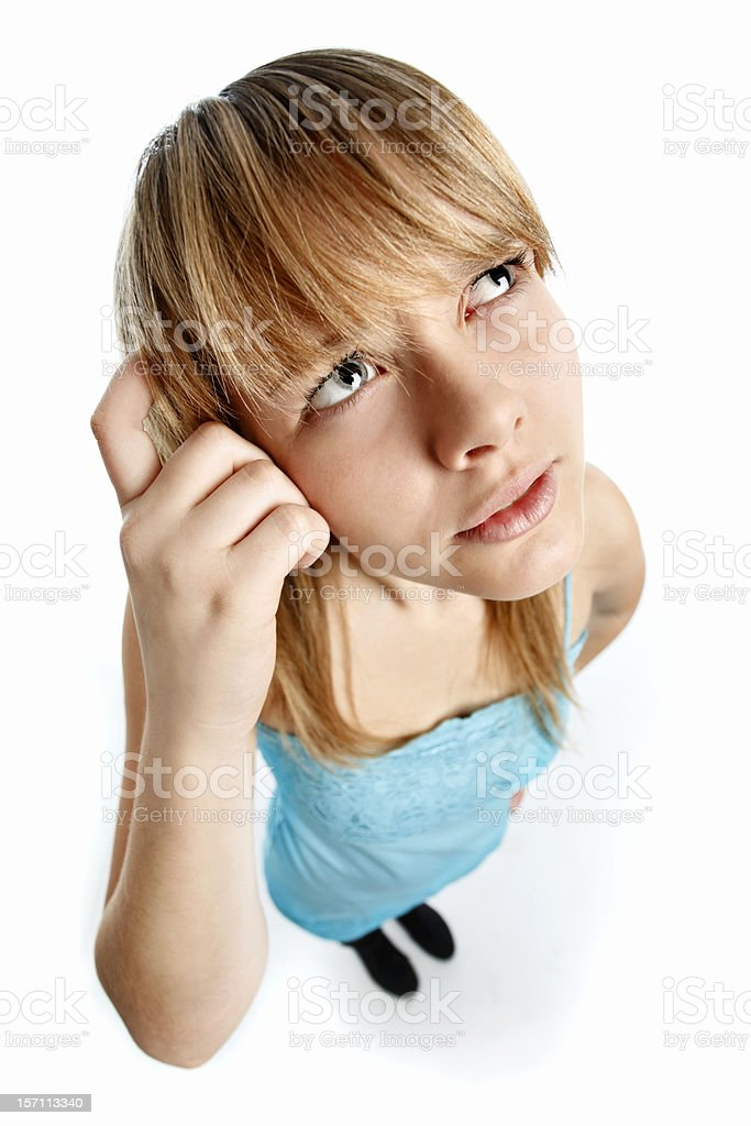 Thinking female teen scratches head stock photo