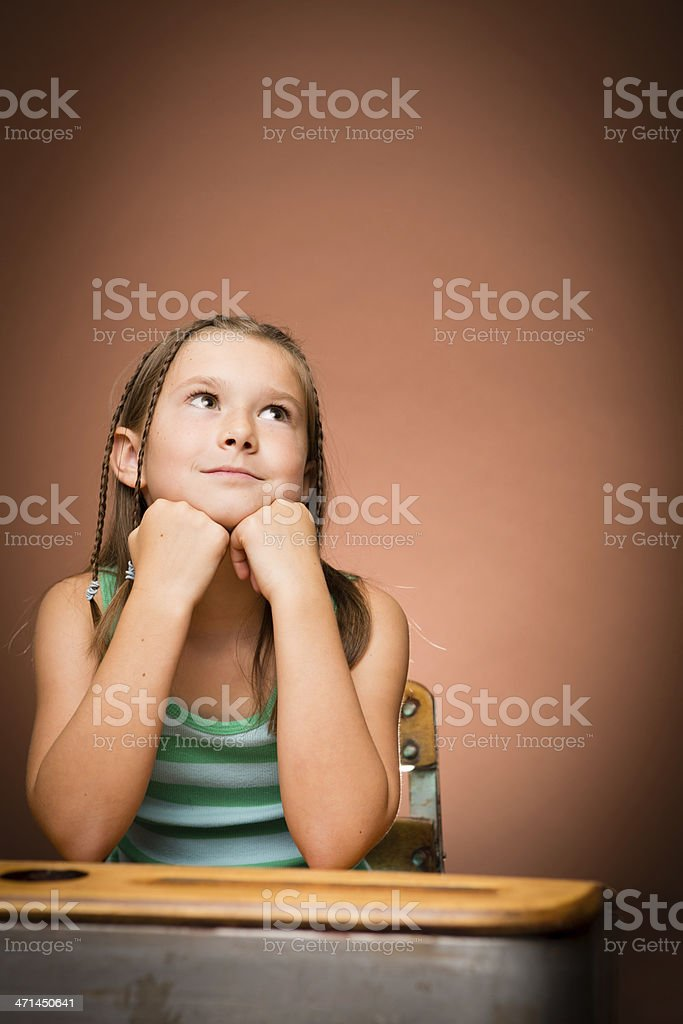 Thinking Girl Student Sitting at School Desk, With Copy Space royalty-free stock photo