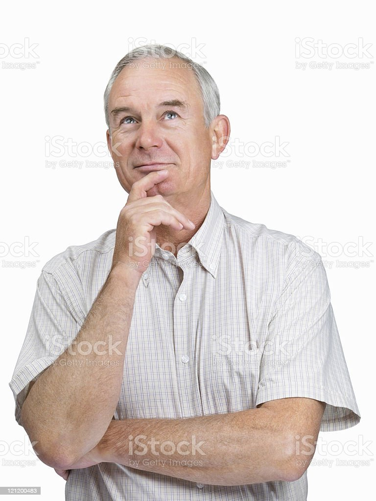 Thinking - Handsome older man looking up on white royalty-free stock photo