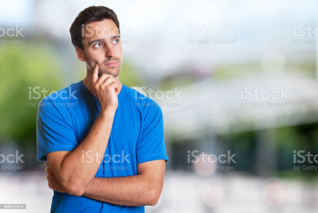 Thinking hispanic man with beard stock photo