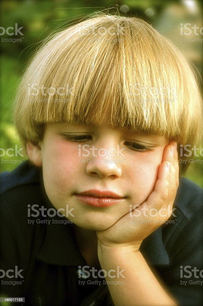 thinking in boy hood stock photo