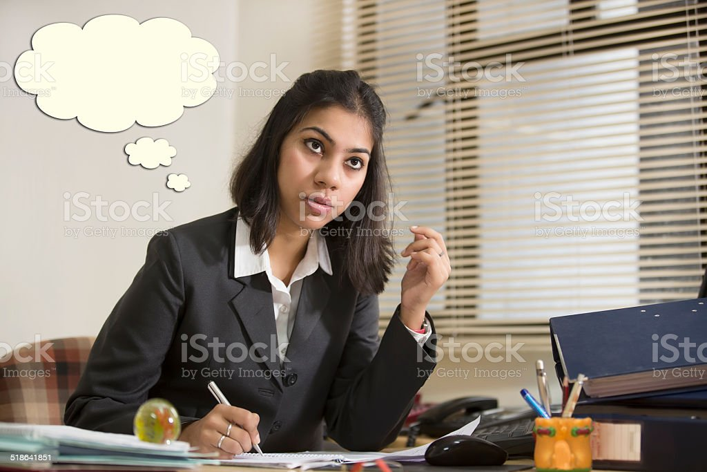 Thinking Indian Business woman with Thought Bubble. stock photo